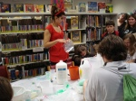 Amanda helps out kids make slime.