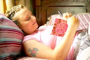 female writing in journal